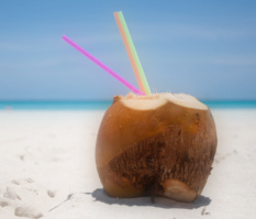 healthy coconut beverage on tropical beach